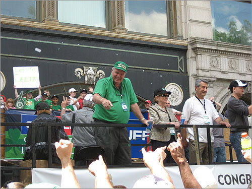 Tommy Heinsohn, a former Celtics player, coach and current television color commentator, gestured to the crowd.