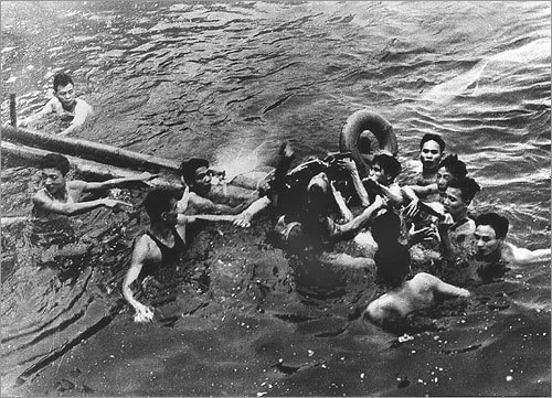 This Oct. 26, 1967, file photo shows Navy fighter pilot John McCain (center), the 2008 Republican presidential nominee, being captured by Vietnamese civilians in Truc Bach Lake near Hanoi, Vietnam. McCain, whose plane was shot down while he was serving in the Vietnam War, was tortured and imprisoned for more than five years as a prisoner of war.