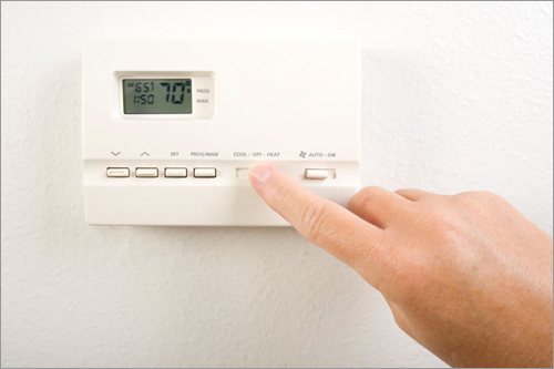 Adjust your thermostat The simplest way to curb heating costs doesn't have to involve buying expensive apparatuses, it can start right at home. Adjust your thermostat by turning it down when you're not home. By turning your thermostat back 10 or 15 degrees for eight hours, the U.S. Department of Energy estimates that households can save 10 percent a year on heating and cooling bills. A programmable thermostat (left) offers users more flexibility when they're not home.