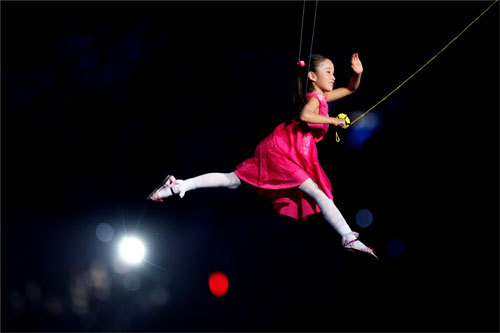 A young dancer performed at the opening ceremonies while suspended in the air.
