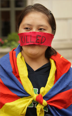 A Tibetan protester in London, England stood outside the Chinese Embassy.