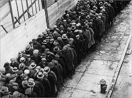 The homeless and out-of-work of the Depression in line for shelter in New York.