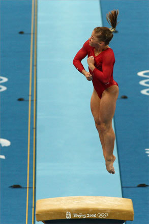 Shawn Johnson of the United States propelled herself into the air on the vault.