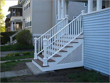 AFTER Location: Front stairs Boulos rebuilt the front stairs using treated lumber with mahogany treads and railings.