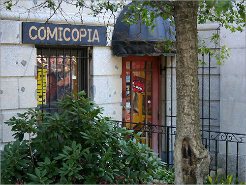 Comicopia, a comic book store. The store offers a wide range of comic books, paperbacks, and comic book merchandise.