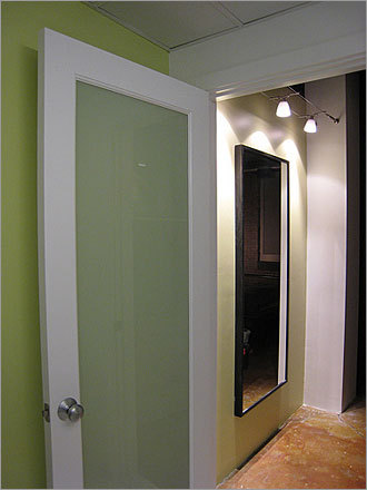 After Who: Dartagnan Brown Where: Everett What: Loft remodel The new bathroom door is shown here, along with the finished walls and lights.