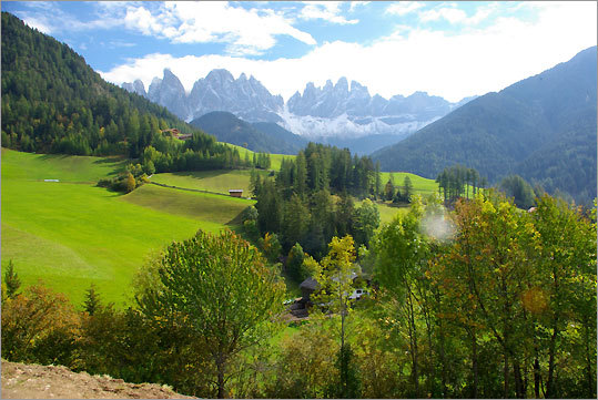 In the Val di Funes region of Northern Italy, a vista sweeps across the Geisler Range of the Dolomite Mountains.