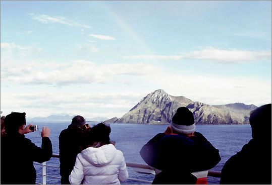 Passengers gather on deck as the ship rounds Cape Horn.