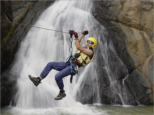 A tourist enjoys a zip line adventure in the northeast region of Canovanas.