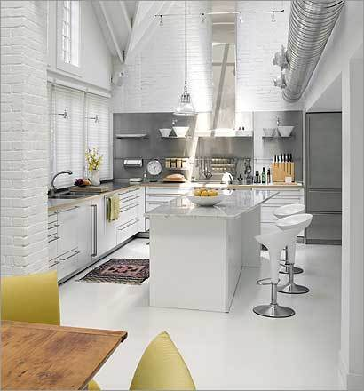 Modern-design-white-kitchen-island-with-cabinets-and-bar-stools