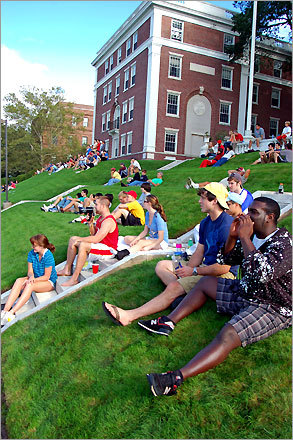 Wesleyan University fans watch the football game against Hamilton College and make themselves heard (one with a bullhorn) from the terrace below the Olin Memorial Library. Hamilton won the New England Small College Athletic Conference game, 17-7.