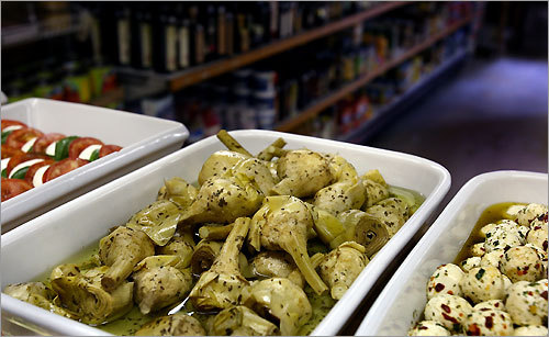 Antipasti vegetables at Salumeria Italiano include artichokes in oil.