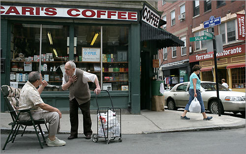Longtime North End resident John Rosato (left) chats with Thomas M. Damigella in front of Polcari's Coffee.