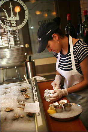 Adriana Munetone shucks oysters at Neptune Oyster on Salem Street.