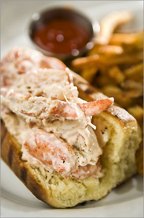 A lobster roll from Neptune Oyster. Sandwiches and entrees cost $13.50 to $34.