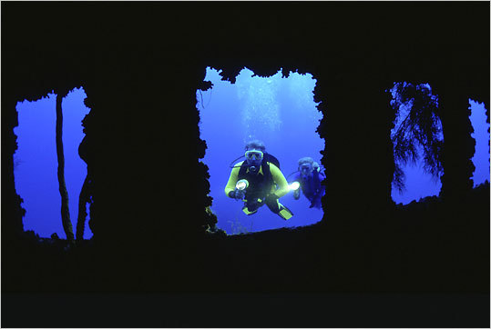 Investigating a shipwreck on a scuba dive off Curaçao.