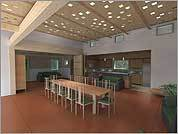 The president's house at Unity College in Maine has walls that open and close to reconfigure the interior.