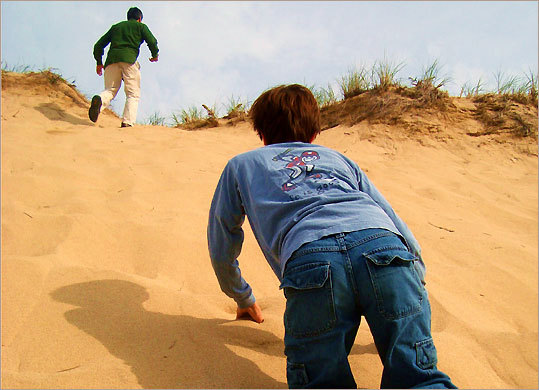 Fyodor, 11, follows his father's lead on a geocache search.