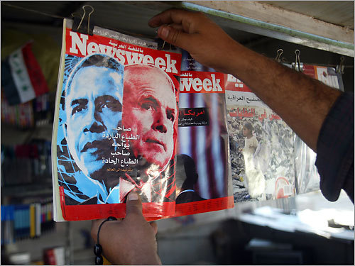 Baghdad A kiosk owner in central Baghdad attached a magazine cover with the images of Senators John McCain and Barack Obama.