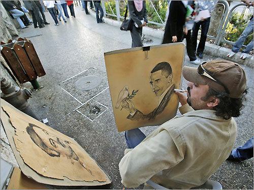 West Bank Palestinian painter Waleed Ayyoub added the last touches on a painting he made of Democratic candidate Barack Obama in the center of the West Bank city of Ramallah.