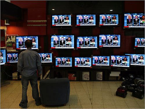 Jerusalem An Israeli man watched TV screens with news reports on the presidential elections in a Jerusalem mall.