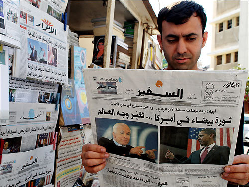 Beirut A Lebanese man read a newspaper with photos of candidates John McCain and Barack Obama on its front page at a newsstand in Beirut.
