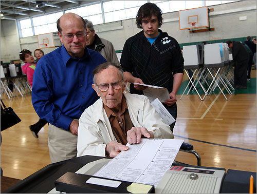 Three generations of the Beecher family, grandfather, Milton, 99, father, Edward, 59, and Edward's son, Robert, 18, voted together at Hopkinton Middle School.