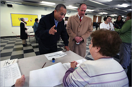 Governor Deval Patrick and his neighbor, Senator Brian A. Joyce, checked in at Milton's Precinct 2 in St. Mary of the Hills School.