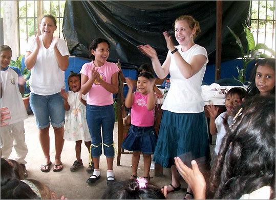 Allisa Whitman and her sister Rachel (left) teaching the children of San Jose Villanueva.
