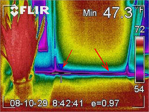 This infrared image of the same door shows the heat gaps in blue.