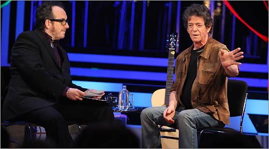 Elvis Costello (left) with Lou Reed on Costello's new music talk show