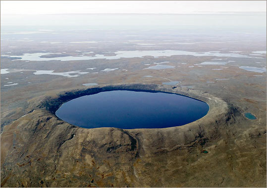 Pingualuit Crater in Quebec's Nunavik region, one of the youngest and best preserved craters on the planet, is 2.1 miles across, a quarter mile deep, and rises 175 yards above the tundra.