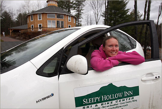 Molly Peters is wedding coordinator at Sleepy Hollow Inn in Huntington, which rewards guests for driving hybrid vehicles.