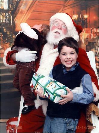 Susie of North Easton, sent in this photo her kids Daniel and Gracie, taken at her work Christmas party in Quincy last December. 'The funny thing about this picture is my son is completely oblivious to his surroundings, he's just happy to have the gift!' she writes.