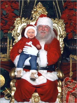 Darcy of Swampscott sent us this photo of Madison with her first photo with Santa.