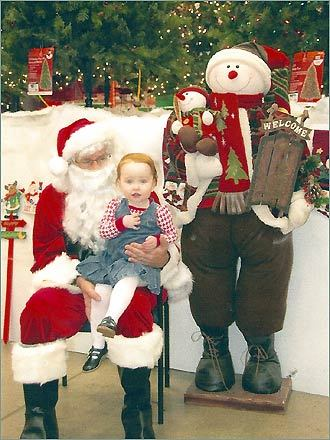 Two-year-old Mairead, of Brighton, saw the big guy at the Home Depot in Watertown.