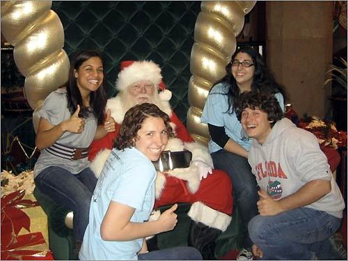 You're never too old to visit Santa, as this crop of 20-year-old undergrads prove. Kristin Yancy of DeSoto, TX, Stephanie Spera, of Brockton, Steve Hardy, of Sarasota, Fla., and Hannah Schwartz - Old Brookville, NY were snapped while on a trip to the mall in St. Louis.