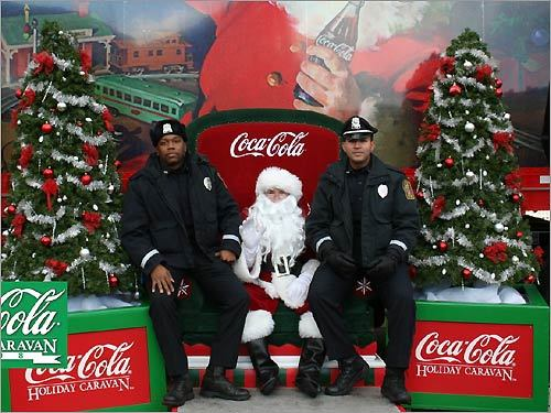 Could Santa be under arrest? The men in blue paid a visit to the man in red. Christian Borrero-Colon of Santurce, Puerto Rico and Malik Morgan (left) both of Boston College Police snapped a photo with the big guy.