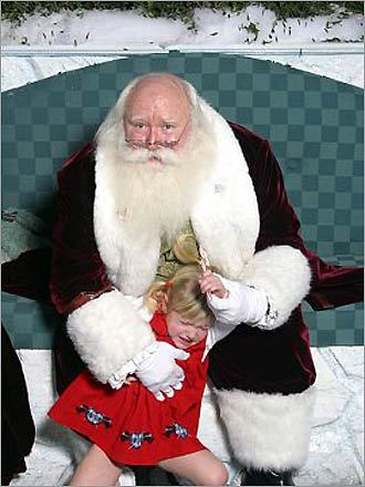 Sophie looked a little scared of Santa in this photo submitted by Tricia of Newtonville, taken at the Burlington Mall in 2003.