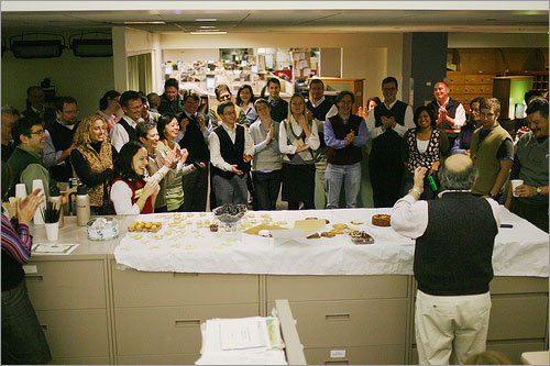 Employees of The Boston Globe are shown gathering for a group Vestival photo on Friday, Dec. 5, 2008, in this photo from Daigo Fujiwara.