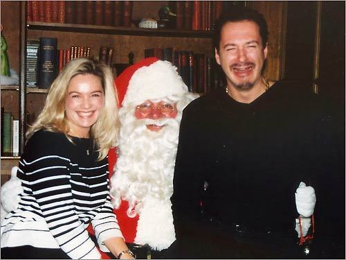 Maureen (left) and Robert Siciliano of Boston took a seat on Santa's lap.