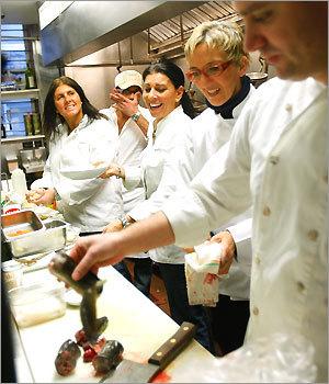 Christine Pallotta (left), Andrea Benatti, Carla Pallotta, and Marisa Iocco watch Dante de Magistris chop up an eel for his wood-grilled eel dish