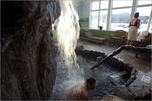 John Epes dips under the waterfall at Stoweflake Mountain Resort & Spa in Stowe, Vt. The daily spa access fee is $20 for hotel guests and $40 for non-guests. The fee is waived with the purchase of a spa treatment.