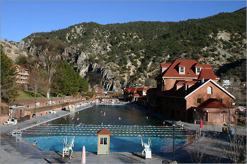 The 1890 red sandstone bathhouse and lodge on the right at Glenwood Hot Springs in Colorado were designed by Viennese architect Theodore Von Rosenberg.