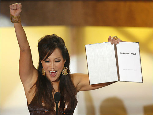 Presenter Carrie Ann Inaba presents the award for favorite new comedy for 'Gary Unmarried' at the 35th annual People's Choice awards in Los Angeles on Jan. 7, 2009.