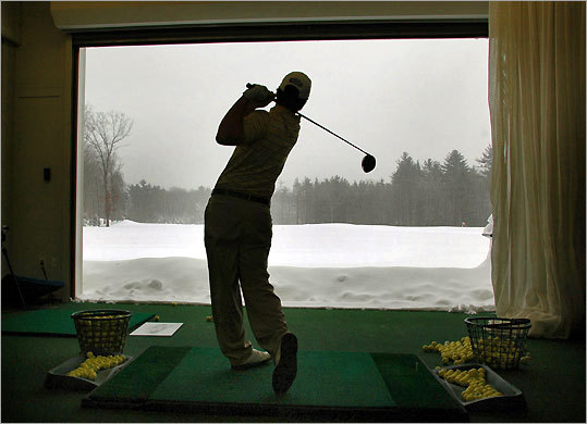 On a snowy day last month, Taylor Fontaine, 18, Southbridge practiced his swing from a heated bay at Harmon Golf and Fitness Club in Rockland.