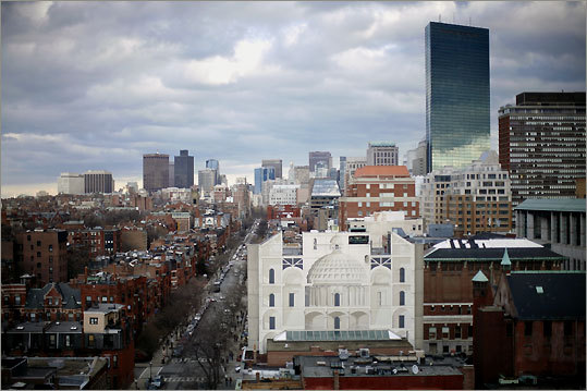 The John Hancock Tower stands like a shining monolith over downtown, with Newbury Street, one of Boston's chief shopping venues, stretching into the distance from the foreground.