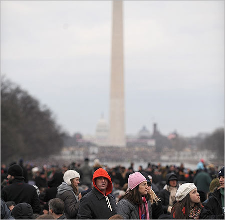 People waited by the Reflecting Pool on the National Mall before the start of the We Are One concert, one of the events of US president-elect Barack Obama's inauguration celebrations, at the Lincoln Memorial on Sunday.
