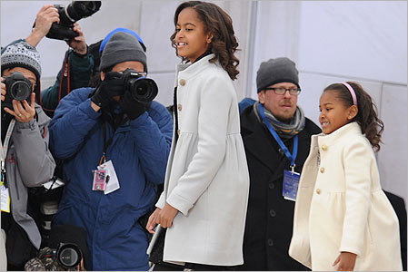 Obama's daughters Malia (left) and Sasha arrived at the concert.