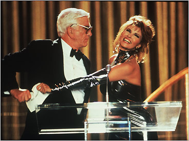 'Naked Gun 33 1/3: The Final Insult' (1994) The envelope with the name of the best picture winner contains a bomb, and Leslie Nielsen's Frank Drebin - masquerading as Phil Donahue! - is on the case. He crashes the chorus line of a Pia Zadora production number, tackles Raquel Welch, and reverse peristalts into a tuba. Imagine what he might have done if Barbara Walters had interviewed him beforehand. Pictured: Leslie Nielsen (left) and Raquel Welch.